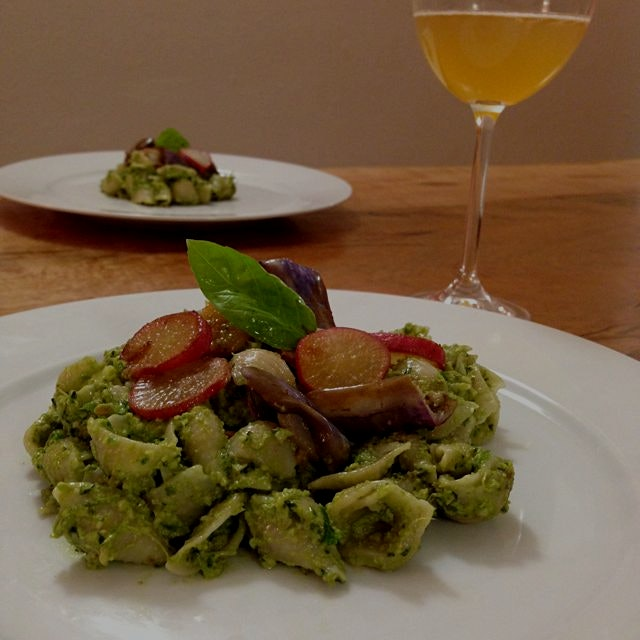 Created a spiced vegan kale basil pesto brown rice pasta topped with sautéed fairytale eggplant p...
