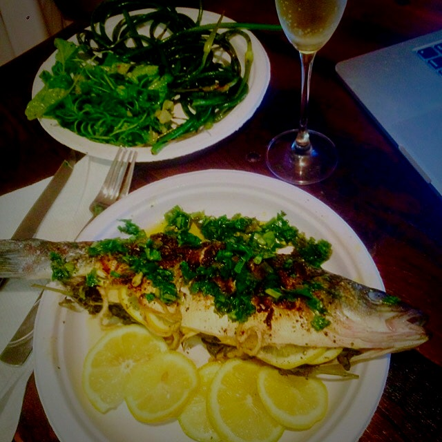 Finished product:  grilled sustainable Branzini with herb, garlic, and lemon gremolata, grilled g...