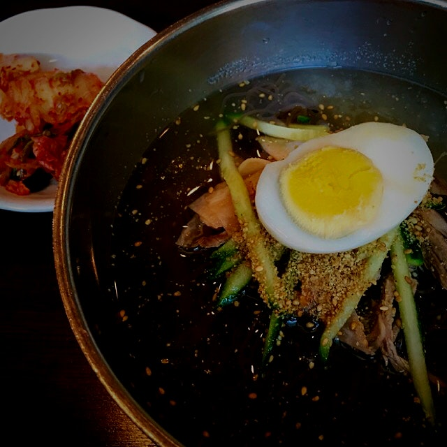 In the summer heat a bowl of Korean Mul Naengmyeon which is a cold noodle soup is very refreshing...