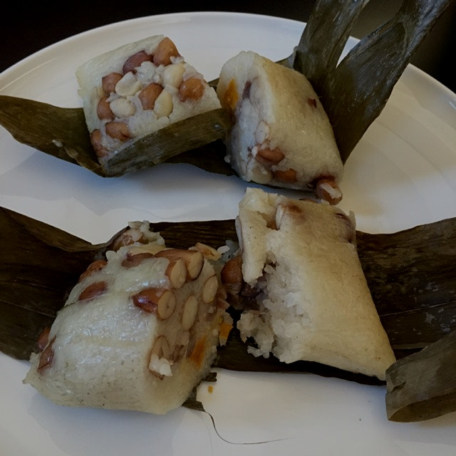 Now this friend of mine is having this Jung, sort of a Chinese Tamales, homemade. And I'm droolin...