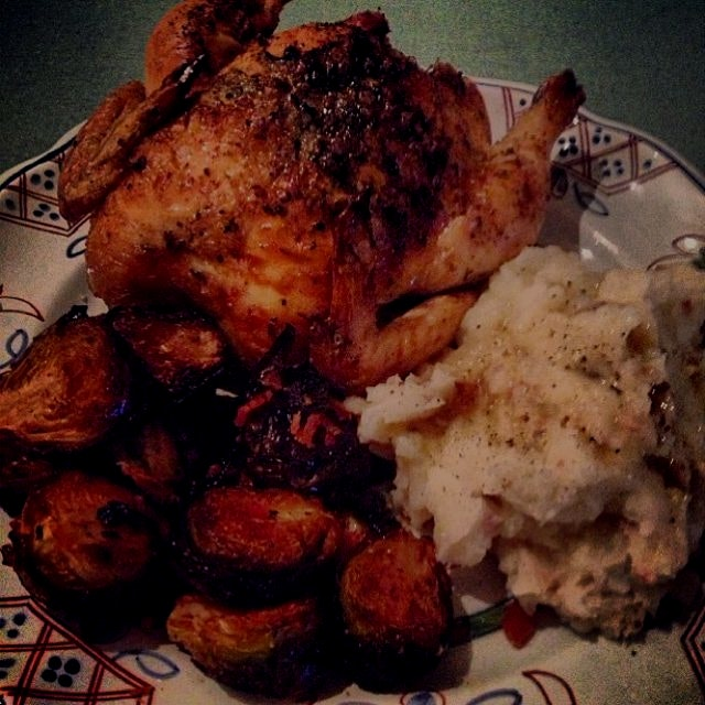 New Year's Dinner dream come true: roasted Cornish Game Hens with apple, lemon, carrot, and celer...