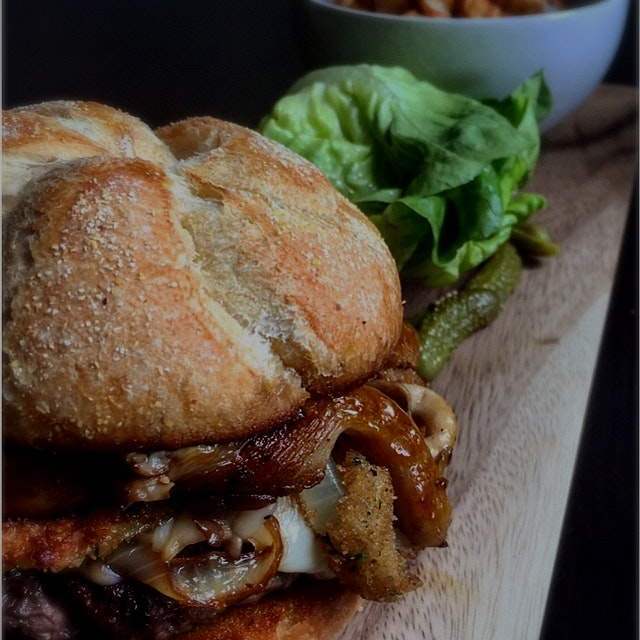 Taleggio Cheeseburger with honey aioli, oyster mushrooms, caramelized onions and onion rings for ...