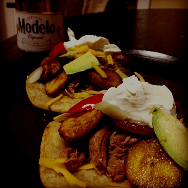 One of my specialties: carnitas tacos with sliced avocado, sweet plantains seared with brown suga...