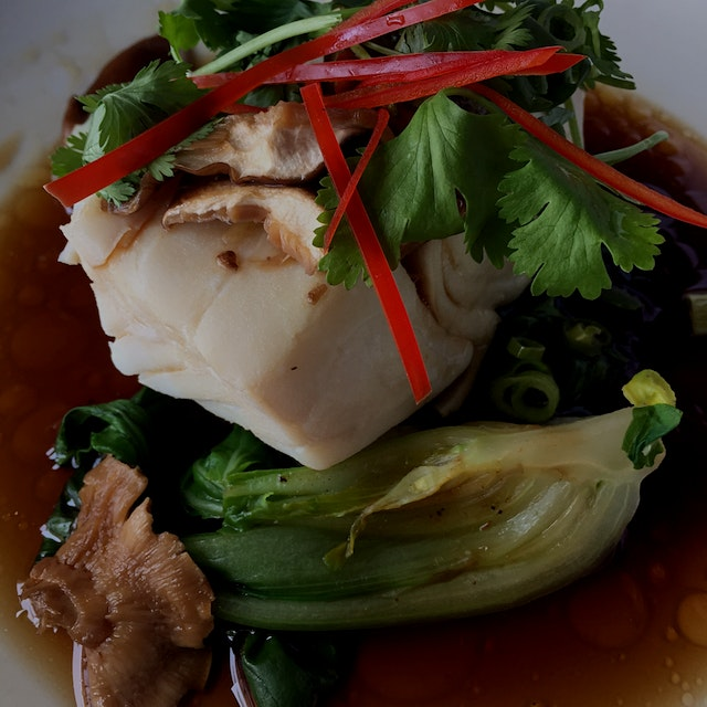 Steamed fish and veggies in an amazing simple broth of soy, sugar and water.