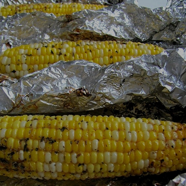 Roasted corn on the cob with herbs and butter