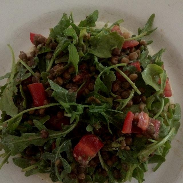 Lentil salad on top of arepa