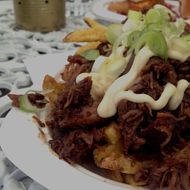 Sticky pork over hand-cut french fries - perfect winter comfort food.