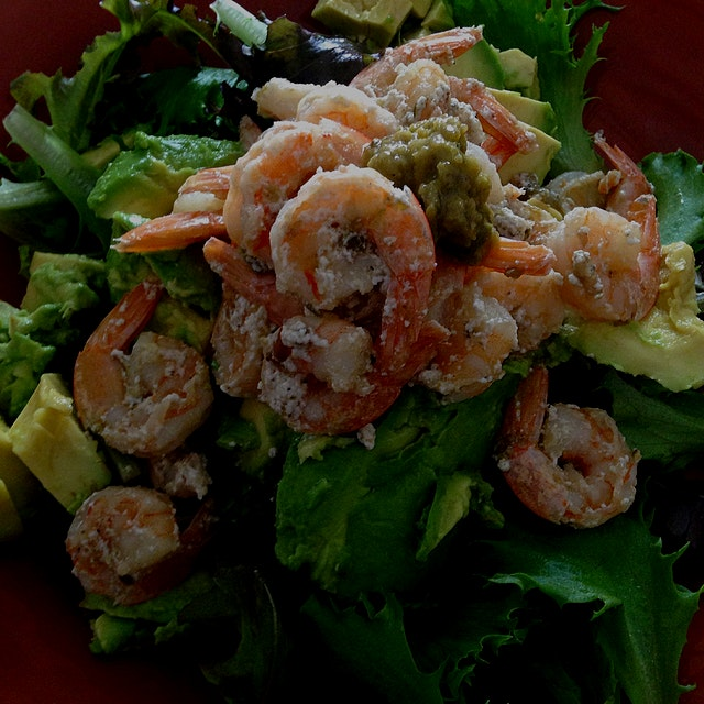 Lunch! Shrimp cooked in coconut milk and Lime Leaf Sambal atop mixed greens and avocado. Easy pea...