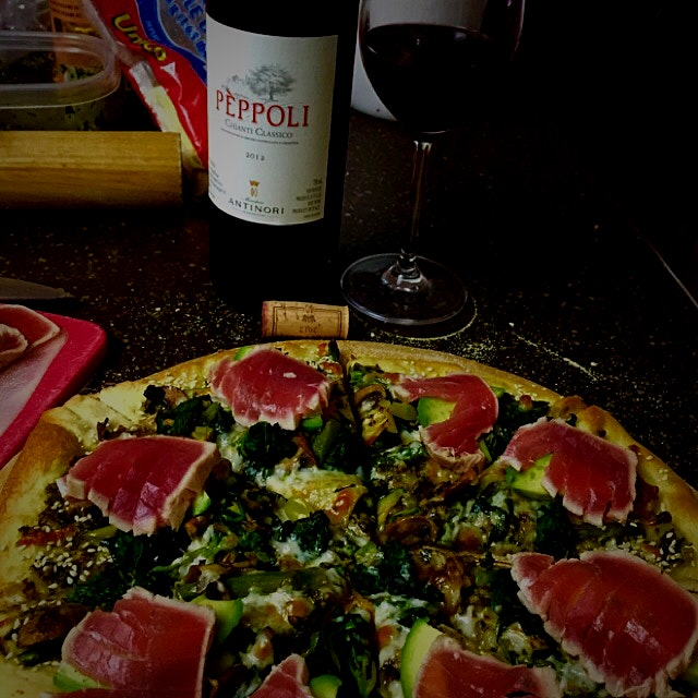 Date night at home with homemade pizza. Add seared tuna after it came off the pizza stone. Decade...