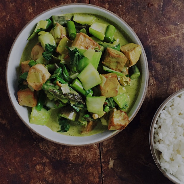 Green vegetable and tofu coconut curry flavored with Brooklyn Delhi roasted garlic achaar, cilant...