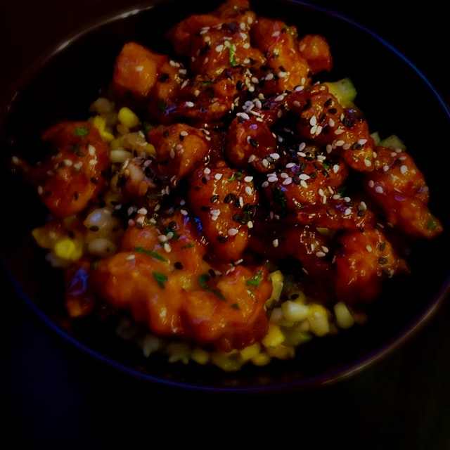 Pushed through the heat and made a tasty dinner. Mandarin chicken, a la Trader Ming, served on a ...