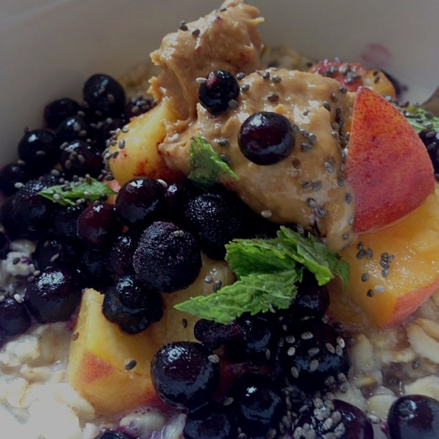 so energized with my oatmeal sweetened by dates topped with fruits, peanut butter, chia seeds (pr...