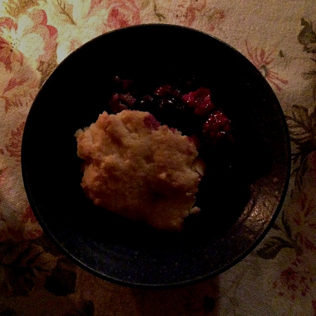 Mom's berry cobbler by candlelight