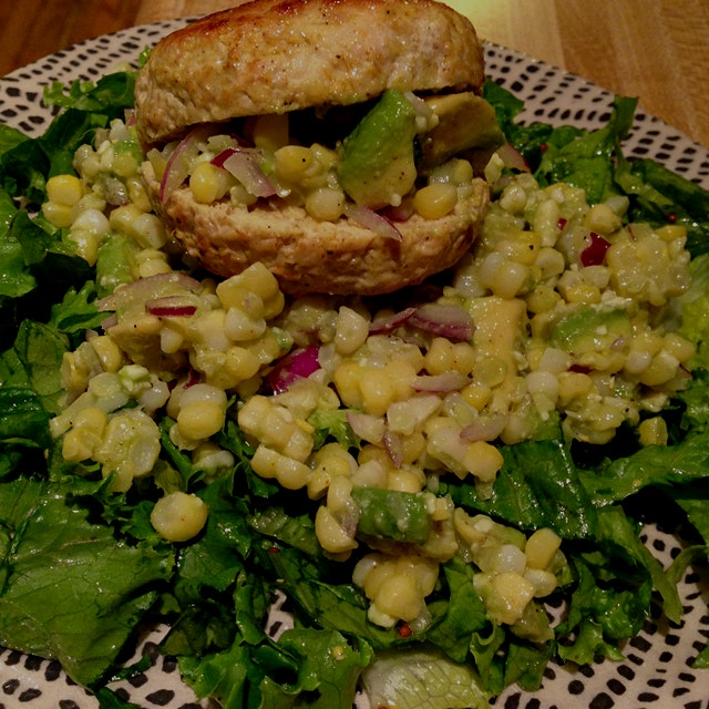 Alberto's night to cook! Tender, local chicken burger atop corn salad laced with red onion in hon...