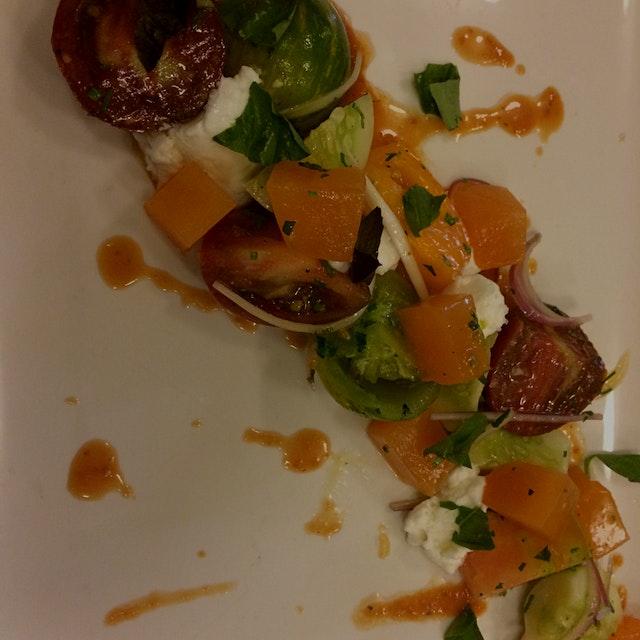 Tomato and melon salad with a smoked tomato vin and burrata sorbet.