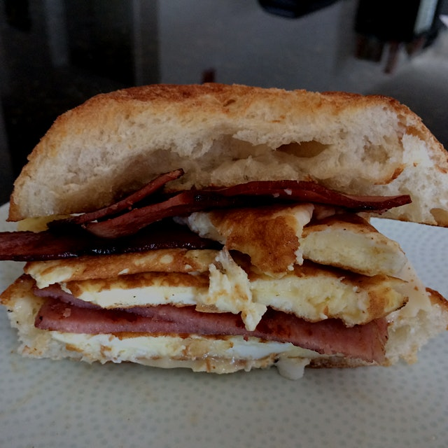 Whipped up this bad boy today. Portuguese roll hand toasted with a garlic olive oil butter mix. E...
