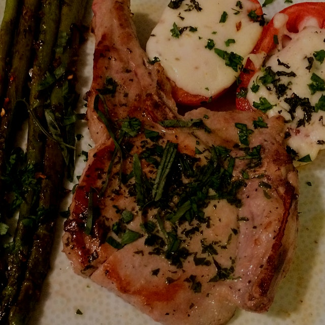 Italian Pork Chop with Mozzarella Baked Tomatoes and Asparagus. Haven't quite got the hang of pla...