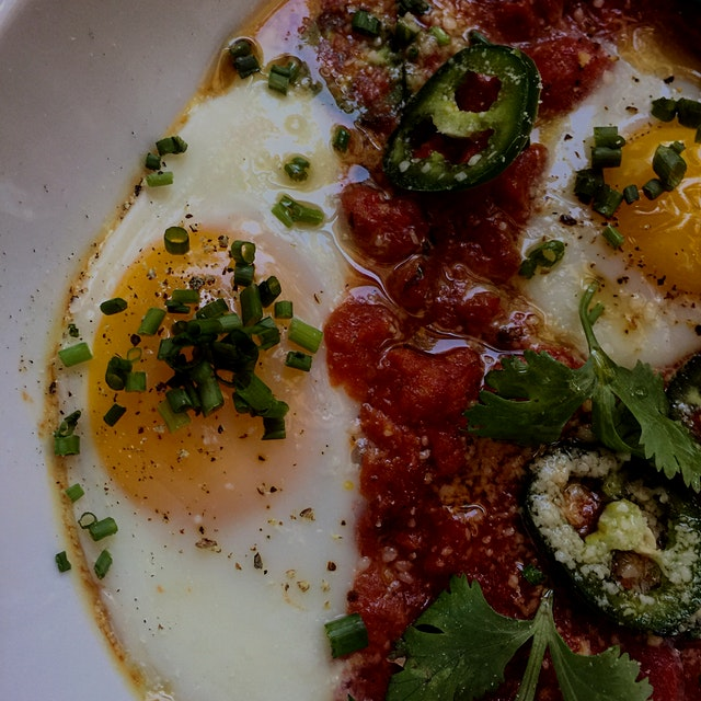Huevos Rancheros with spicy pork and tomato chili