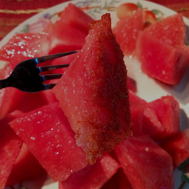 Fresh watermelon with chili, salt, and lime