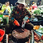 Ladies dominate fish and meat butchery at the Old Market in Siem Reap. This #ladyboss was going to town on this monkfish!