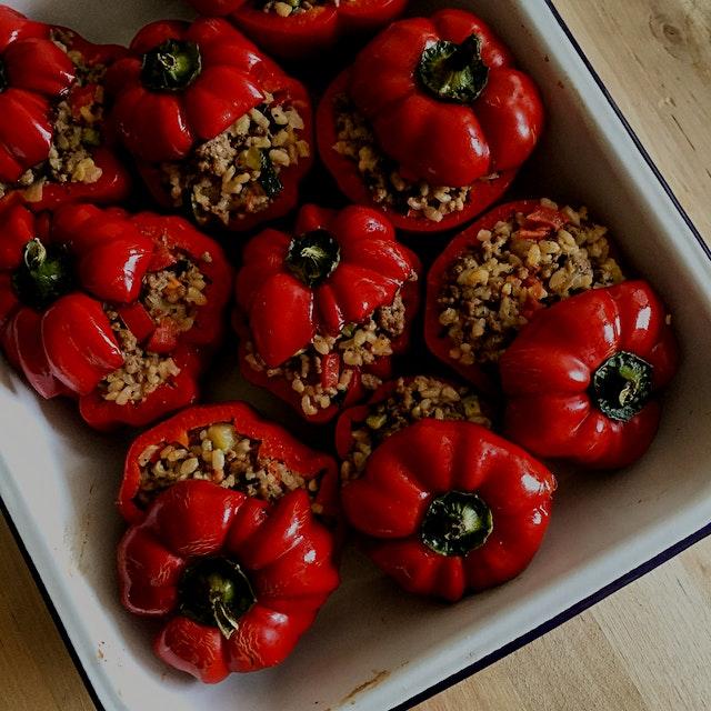 Stuffin' muh Peppers Greek style. Chicken, brown rice, feta, zucchini, tomato, oregano, chilli fl...