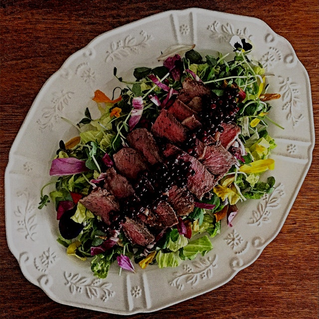 The attempt to hang on to summer for a few more days. Grilled ribeye and elderberries over greens...