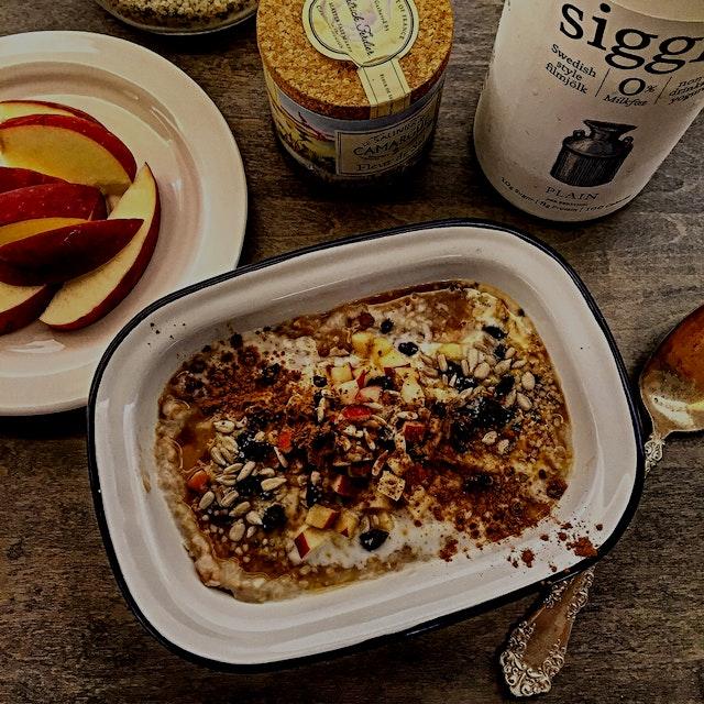 Breakfast goes autumnal: Apple Crisp baked porridge with yogurt and seed topping.