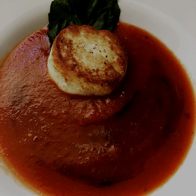 A twist on a classic... Tomato Basil Soup with Balsamic Gastrique and Fried Mozzarella...   Vegan...