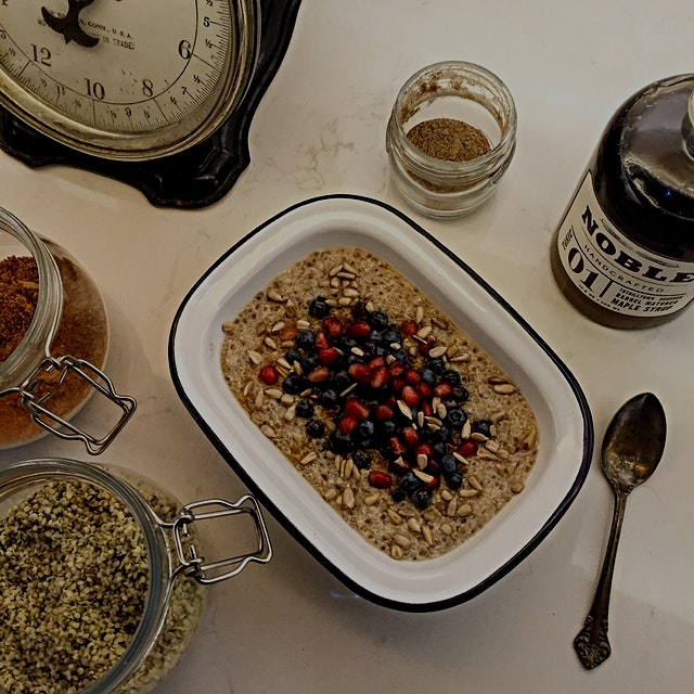 'Stick to your ribs' porridge bowl. Combo of quinoa, chia and kasha warmed up with cinnamon and c...