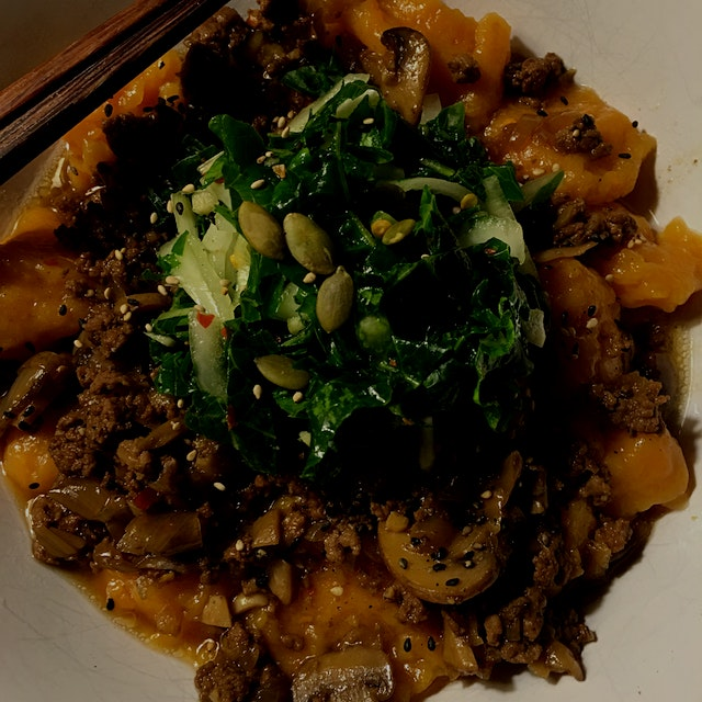 Sweet potato dumplings with Taiwanese meat and mushroom sauce and quick-pickled kale