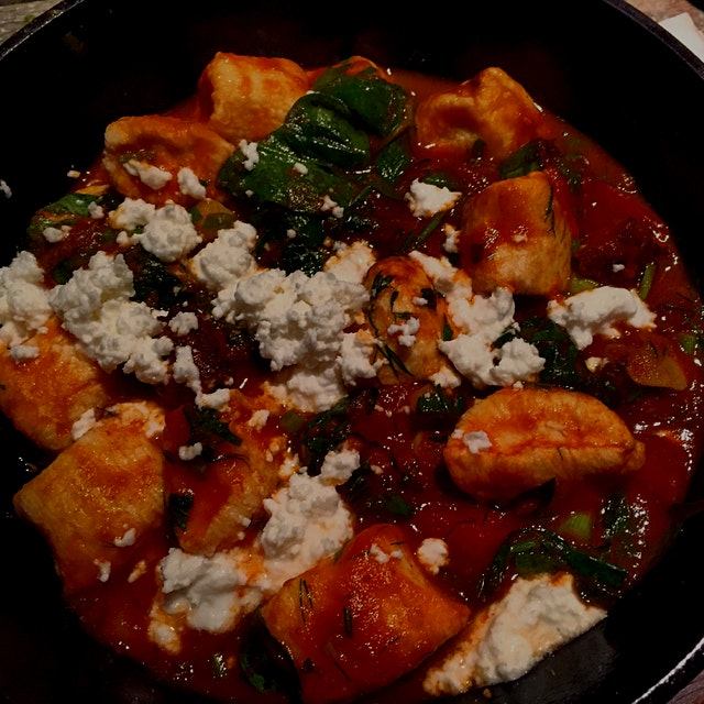 Dumplings with spicy lamb sausage, sun-dried tomato, pine nut, spinach, tomato and feta. Greek fo...