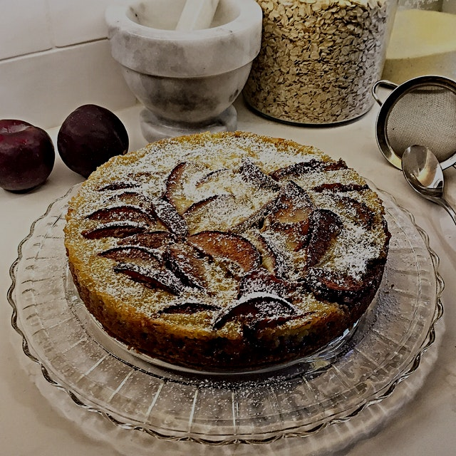 Spiced Plum Custard Cake. Partially bake the cake batter and plum layer. Remove from oven and add...