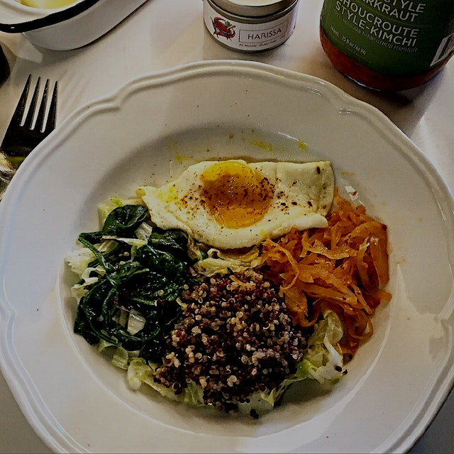 Starting the day savoury. Sautéed spinach and Chinese lettuce, quinoa, kimchi and Harissa dusted ...