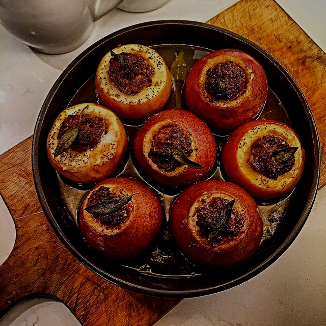Well, stuff my apples! And pears. Hot Italian sausage filled apples and pears roasted in butter, ...