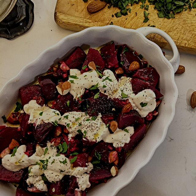 Roasted beets in a sherry vinaigrette with almonds and horseradish spiked creme fraiche. Intrigui...