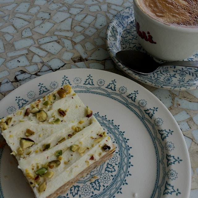 Today's afternoon tea situation: Orange & pistachio slice with a great New Zealand flat white.