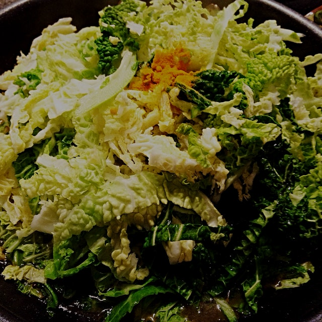 Savoy cabbage in my sauté pan. Cooked the way my mum always did most leafy veggies - with fenugre...