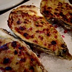 Baked oysters with Gruyere cheese.